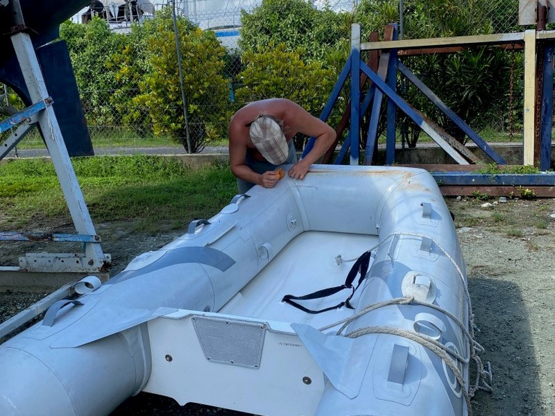 Preparing our sailboat - a patch for the dingy in Raiatea French Polynesia